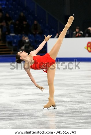 BUDAPEST, HUNGARY - JANUARY 15, 2014: Adelina SOTNIKOVA of Russia performs short program at ISU European Figure Skating Championship in Syma Hall Arena. - stock photo