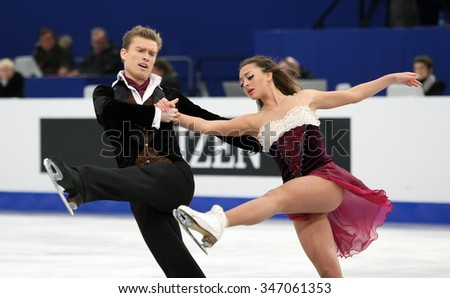 BUDAPEST, HUNGARY - JANUARY 16, 2014: Ekaterina RIAZANOVA / Ilia TKACHENKO of Russia perform free dance at ISU European Figure Skating Championship in Syma Hall Arena. - stock photo