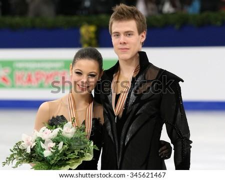 BUDAPEST, HUNGARY - JANUARY 16, 2014: Elena ILINYKH / Nikita KATSALAPOV pose at the victory ceremony at ISU European Figure Skating Championship in Syma Hall Arena. - stock photo