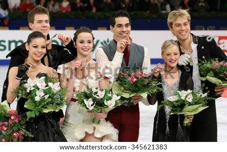 BUDAPEST, HUNGARY - JANUARY 16, 2014: ILINYKH/KATSALAPOV (L), CAPPELLINI/LANOTTE, COOMES/BUCKLAND  pose at the victory ceremony at ISU European Figure Skating Championship in Syma Hall Arena. - stock photo