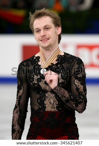 BUDAPEST, HUNGARY - JANUARY 18, 2014: Sergei VORONOV of Russia poses at the victory ceremony at ISU European Figure Skating Championship in Syma Hall Arena. - stock photo