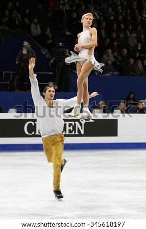 BUDAPEST, HUNGARY - JANUARY 19, 2014: Tatiana VOLOSOZHAR / Maxim TRANKOV of Russia perform free program at ISU European Figure Skating Championship in Syma Hall Arena. - stock photo