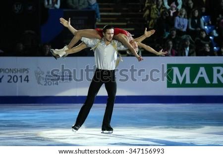 BUDAPEST, HUNGARY - JANUARY 19, 2014: Tatiana VOLOSOZHAR / Maxim TRANKOV perform during the exhibition gala at ISU European Figure Skating Championship in Syma Hall Arena. - stock photo