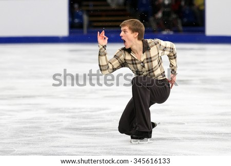 BUDAPEST, HUNGARY - JANUARY 16, 2014: Tomas VERNER of Czech Republic performs short program at ISU European Figure Skating Championship in Syma Hall Arena. - stock photo