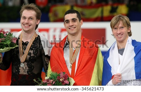 BUDAPEST, HUNGARY - JANUARY 18, 2014: VORONOV (L), FERNANDEZ, MENSHOV pose at the victory ceremony at ISU European Figure Skating Championship in Syma Hall Arena. - stock photo