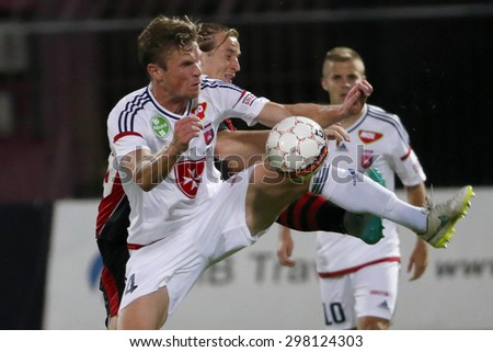 BUDAPEST, HUNGARY - JULY 18, 2015: Duel between Patrik Hidi of Honved (r) and Kees Luijckx of Videoton during Honved vs. Videoton OTP Bank League football match in Bozsik Stadium. - stock photo