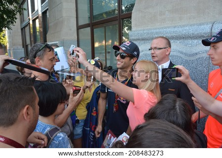 BUDAPEST, HUNGARY-  JULY 26: F1 driver Daniel Ricciardo is among his fans and giving autographs on July 26, 2014 in Budapest. - stock photo