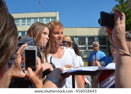 BUDAPEST, HUNGARY-  JULY 21: F1 driver Nico Rosberg is among his fans and giving autographs on July 21, 2016 in Budapest. - stock photo