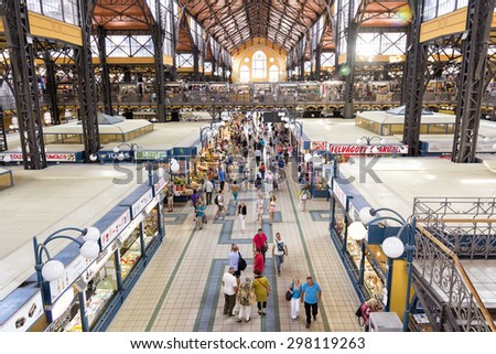BUDAPEST, HUNGARY, JULY 10, 2015: People shopping inside Great Market Hall of Budapest, the largest and oldest indoor market in Budapest, located at the end of famous shopping street Vaci utca. - stock photo