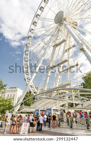 BUDAPEST, HUNGARY, JULY 9, 2015: People waiting in line to get on the famous ferris wheel Sziget's Eye at Erzsebet Square. - stock photo