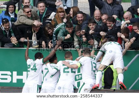 BUDAPEST, HUNGARY - MARCH 7, 2015: Players of Ferencvaros celebrate with their fans during Ferencvaros vs. Gyori ETO OTP Bank League football match in Groupama Arena.  - stock photo