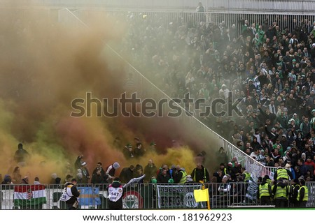 BUDAPEST, HUNGARY - MARCH 16, 2014: Supporters of Ferencvaros explode smoke bombs during Ferencvaros vs. Debreceni VSC OTP Bank League football match at Puskas Stadium.  - stock photo