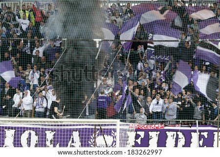 BUDAPEST, HUNGARY - MARCH 23, 2014: Supporters of Ujpest celebrate during Ujpest vs. DVTK OTP Bank League football match at Szusza Stadium. - stock photo
