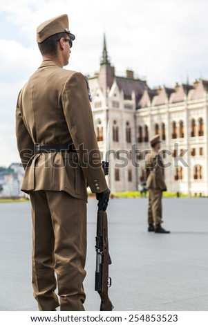 BUDAPEST, HUNGARY - MAY 5: Ceremonial changing of the guard at the entrance of the Hungarian parliament on the day of constitution on May 5, 2014 in Budapest, Hungary.  - stock photo