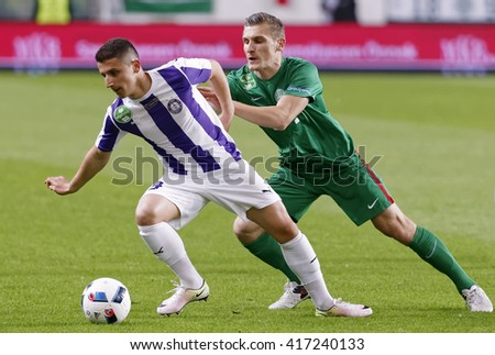 BUDAPEST, HUNGARY - MAY 7, 2016:  Enis Bardhi (L) of Ujpest FC fights for the ball with Emir Dilaver of FTC during the Hungarian Cup Final football match between Ujpest FC and FTC at Groupama Arena - stock photo