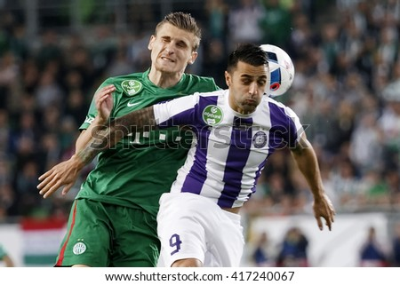 BUDAPEST, HUNGARY - MAY 7, 2016:  Laszlo Lencse #9 of Ujpest battles for the ball in the air with Emir Dilaver of FTC during the Hungarian Cup Final match between Ujpest FC and FTC at Groupama Arena - stock photo