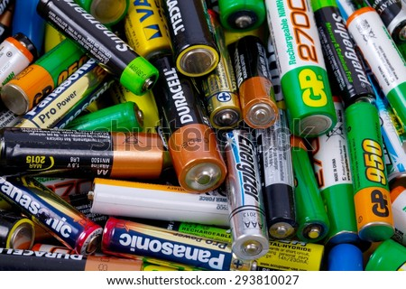 BUDAPEST, HUNGARY - MAY 22, 2015: Many used AA and AAA sized batteries in a pile. - stock photo