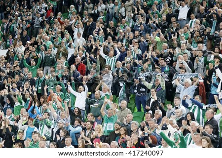 BUDAPEST, HUNGARY - MAY 7, 2016: The supporters of Ferencvarosi TC celebrate the victory during the Hungarian Cup Final football match between Ujpest FC and Ferencvarosi TC at Groupama Arena - stock photo