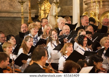BUDAPEST, HUNGARY - NOVEMBER 20: The Budapest Youth Choir performs at the Szent TerÂz Templom on Nov 20, 2010 in Budapest, Hungary - stock photo