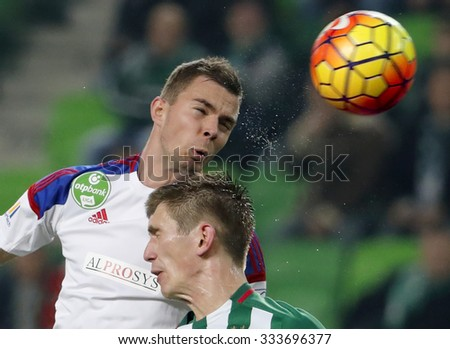 BUDAPEST, HUNGARY - OCTOBER 31, 2015: Air battle between Michal Nalepa of Ferencvaros (r) and Andras Debreceni of Vasas during Ferencvaros vs. Vasas OTP Bank League football match in Groupama Arena.  - stock photo