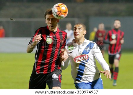 BUDAPEST, HUNGARY - OCTOBER 24, 2015: Duel between Myke Bouard Ramos of MTK (r) and Ivan Lovric of Honved during MTK vs. Honved OTP Bank League football match in Illovszky Stadium. - stock photo