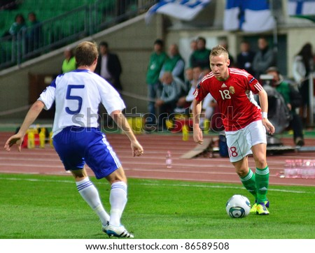 BUDAPEST, HUNGARY - OCTOBER 11 : Hungarian international Balazs Dzsudzsak attacks the finnish side at Hungary - Finland European Cup qualifier football match at October 11, 2011 in Budapest, Hungary. - stock photo