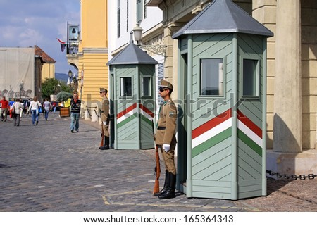 BUDAPEST, HUNGARY - SEPTEMBER 22, 2013: Guards are standing at the Sandor Palace on September 22, 2013 in Budapest. The Sandor Palace is the official residence oft the Hugarian President. - stock photo