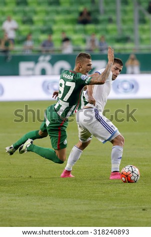 BUDAPEST, HUNGARY - SEPTEMBER 19, 2015: Roland Varga of Ferencvaros (l) is pulled down by Balint Borbely of B'csaba during Ferencvaros vs. Bekescsaba OTP Bank League football match in Groupama Arena.  - stock photo