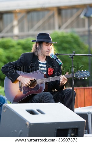 "BUDAPEST-JULY 08: Guitar player and singer Ripoff Raskonikov perform on stage at ""Ter-Film-Zene"" festival July 08, 2009 in Budapest, Hungary - stock photo"