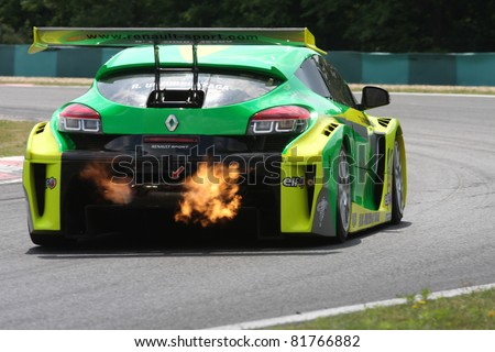 BUDAPEST - JULY 3: Renault Megane race car blowing fire on the Hungaroring race track at World Series by Renault,on July 3, 2011 in Budapest, Hungary - stock photo