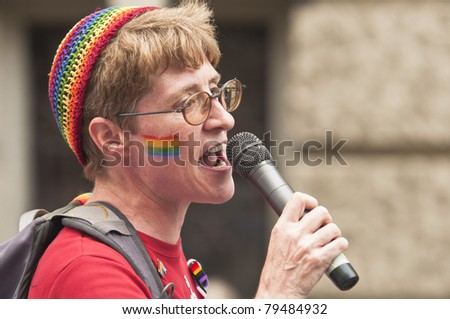 BUDAPEST, JUNE 18: Unidentified woman speaks at the 16th Budapest Pride on 18 June 2011 in Budapest, Hungary. The Budapest Pride in one of the famous gay parades in Central Europe. - stock photo