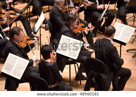 BUDAPEST - MARCH 9: Members of the  Brno Philharmonic Orchestra perform on stage at MUPA on March 9, 2010 in Budapest, Hungary. - stock photo