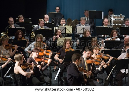 BUDAPEST - MARCH 6: Members of the MAV  Symphonic Orchestra perform on stage at Thalia Theater on March 06, 2010 in Budapest, Hungary. - stock photo