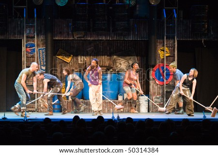 BUDAPEST - MARCH 24: Members of the STOMP perform on stage at Budapest Congress Center on March 24, 2010 in Budapest, Hungary. - stock photo