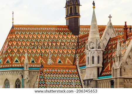 BUDAPEST - MAY 2: People visit Matthias Church in the Castle District. Matthias Church is one of the most famous landmarks of Budapest. on May 2, 2014 in Budapest Hungary.  - stock photo