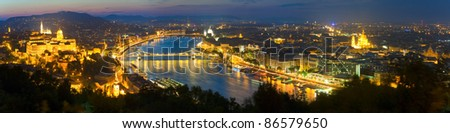 Budapest night panorama view. Long exposure (trees in the foreground out of focus and some in motion blur). - stock photo