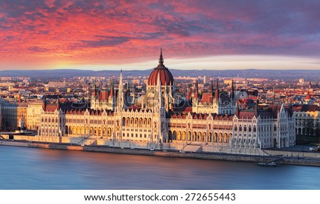 Budapest parliament at dramatic sunrise - stock photo