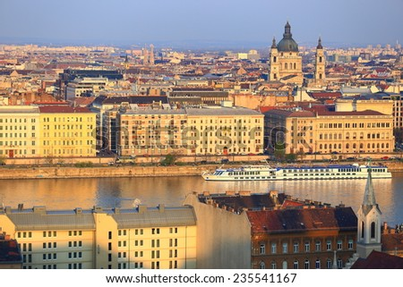 Budapest roof tops and Danube river boats at evening, Hungary - stock photo