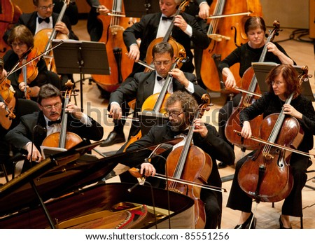 "BUDAPEST - SEPT 18: Magyar Radio Symphonic Orchestra perform on concert at ""Palace of Art"" Budapest Sept 18, 2011 in Budapest, Hungary - stock photo"