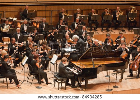 "BUDAPEST - SEPT 18: MR Symphonic Orchestra perform on concert at  ""Palace of Art"" Budapest Sept 18, 2011 in Budapest, Hungary. Conductor:  Gergely Vajda, pianist: Namoradze Nicolas - stock photo"