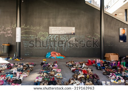 BUDAPEST - SEPTEMBER 7: child shoes for war refugees at Keleti Railway Station on 7 September 2015 in Budapest, Hungary. Refugees are arriving constantly to Hungary on the way to Germany. - stock photo
