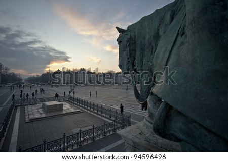 Budapest square of heroes from horse statue's point of view at sunset - stock photo
