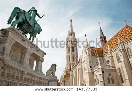 Budapest - St. Matthew's gothic Cathedral and st. Stephen memorial - stock photo