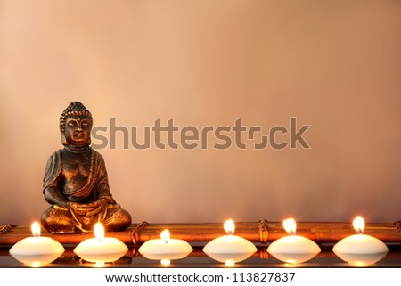 Buddha and candles, religious concept. - stock photo
