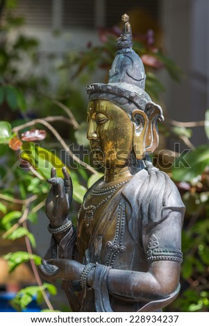 Buddha bronze statue in Gangaramaya Temple. Colombo, Sri Lanka - stock photo