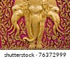 Buddha carved gold paint on church door - stock photo