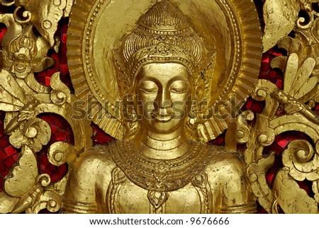 Buddha Carving inside a temple, Luang Prabang, Laos. - stock photo