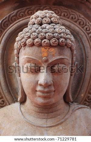 Buddha face , rock engraving - stock photo
