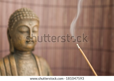 buddha figure with incense stick 2 - stock photo