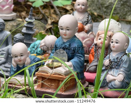 Buddha figurines in the grass, buddhist temple, seoul, south korea - stock photo